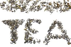 Word TEA made of dry leaves on white background stock images