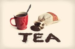 The word tea Mug and tea packaging stock images