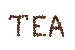Word tea spelled with fried coffee beans Royalty Free Stock Images