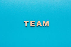 Word Team on blue background Stock Photography