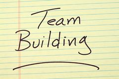 Team Building On A Yellow Legal Pad Royalty Free Stock Photo