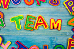 Word TEAM made with plasticine letters on old Royalty Free Stock Photo