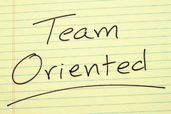 Team Oriented On A Yellow Legal Pad Royalty Free Stock Photo