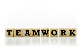 The word Teamwork on wooden cubes Stock Photography