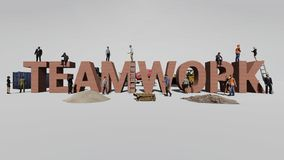 Word teamwork and the workers who work on it stock photo