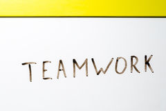 The word teamwork written on a white board Stock Images