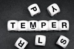 Word temper on toy cubes Stock Image