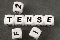 Word tense on toy cubes Stock Photos