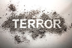 The word terror written in ash as terrorism, war, death, murder,. The word terror written in ash as terrorism, war, fear, death, murder, bomb explosion concept Royalty Free Stock Photos