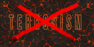 Word terrorism crossed by red paint on danger lava.  Royalty Free Stock Images
