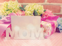 Word text mom and gif box present with space copy backgroud made with vintage filter color Stock Image