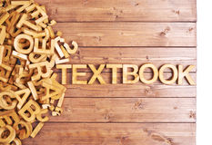 Word textbook made with wooden letters Royalty Free Stock Image