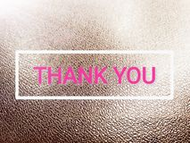Word thank you on black rough leather background royalty free stock images