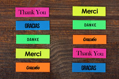 Word Thank you. The word Thank you in different languages. The word Thank you written in multi-colored stickers Royalty Free Stock Photography