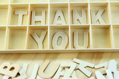 Word thank you made with wooden letters alphabet. Background stock photo
