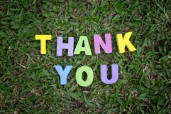 Word thank you spell using colorful alphabet block