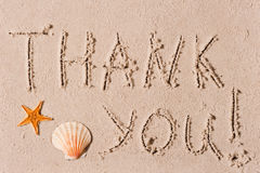 Word of thank you to sand or seashells Stock Image