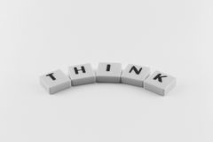 Word think arc. Letters forming the word THINK in arc shape in black and white stock photography