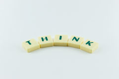 Word think arc. Letters forming the word THINK in arc shape in black and white stock photo