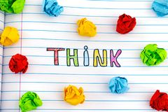 The word Think on notebook sheet with some colorful crumpled paper balls around it. Think. The word Think on notebook sheet with some colorful crumpled paper royalty free stock photo