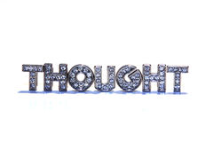Word THOUGHT on white background. Letters with rhinestone form the word THOUGHT isolated on white background, Synonym for idea, mind, notion Stock Images