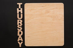 Word Thursday with blank wooden board. Timetable, day of week, to-do-list, time management concept Royalty Free Stock Photos
