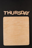 Word Thursday with blank wooden board. Timetable, day of week, to-do-list, time management concept Stock Photo