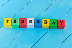 The word Thursday written in child's color wooden Stock Photos