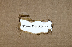 The word time for action appearing behind torn paper Royalty Free Stock Images