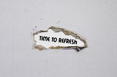 The word time to refresh appearing behind torn paper Royalty Free Stock Photography
