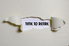 The word time to retire appearing behind torn paper Royalty Free Stock Images