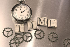 Word - time and watch. Watch and word time sepia vintage style on metal background Stock Photography
