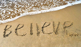 A word to believe. On the beach royalty free stock images