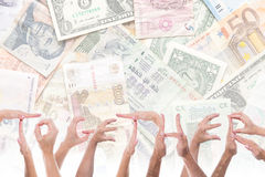 Word together in front of different currencies Stock Photography