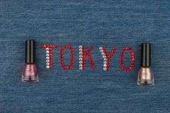 Word Tokyo, made of rhinestones, encrusted on denim. World Fashion. Royalty Free Stock Photography