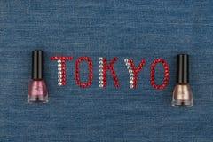 Word Tokyo, made of rhinestones, encrusted on denim. World Fashion. Royalty Free Stock Photography