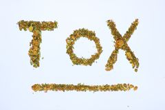Symbol of toxic written with plant of cannabis on white background royalty free stock photo
