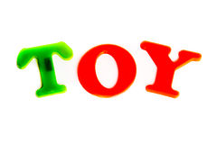 Word toy. From magnetic letters white isolated Stock Photos