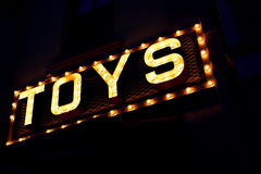 The word TOYS in lights on a sign Stock Photo