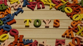 The word toys wooden letters in different color. Royalty Free Stock Photo