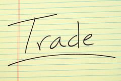 Trade On A Yellow Legal Pad Royalty Free Stock Photo
