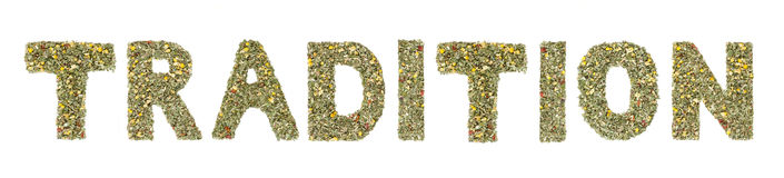 Word TRADITION spelled out with herbs and tea leaves. Word tradition carefully spelled out with herbs and tea leaves by hand, leaving the interpretation of the Royalty Free Stock Photo