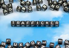 The word Trafficker. On the sky background Royalty Free Stock Image