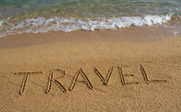 Word travel on the beach. Royalty Free Stock Photos