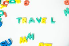 Word Travel lined with multicolored letters on a white background Top view Stock Photos