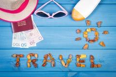 Word travel with shape of sun, sunglasses, sun lotion, straw hat, passport with polish money Stock Photography