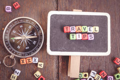 word TRAVEL TIPS block on wooden signage.classic and faded color effect Royalty Free Stock Image