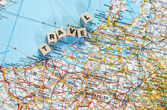 The word travel written in cubes and map. The word travel written in cubes and part of western Europe map Stock Photo