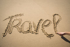 The word travel written in the sand Royalty Free Stock Images