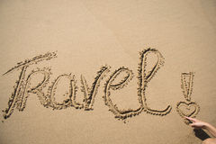 The word travel written in the sand Royalty Free Stock Photo